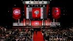 Montreal Canadiens representatives work on their third round select of the NHL hockey draft, Saturday, June 24, 2017, in Chicago. (AP Photo/Nam Y. Huh)