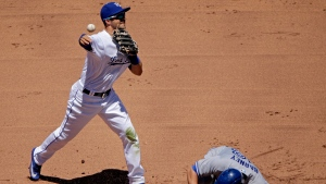 Kansas City Royals second baseman Whit Merrifield throws to first for the double play hit by Toronto Blue Jays' Jose Bautista after forcing Darwin Barney out at second during the fifth inning of a baseball game Saturday, June 24, 2017, in Kansas City, Mo. (AP Photo / Charlie Riedel)