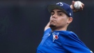 Toronto Blue Jays closer Roberto Osuna warms up during baseball spring training in Dunedin, Fla., on Wednesday, February 22, 2017. THE CANADIAN PRESS/Nathan Denette