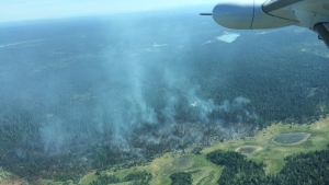 A wildfire burning about 40 kilometres southwest of Lac la Hache is pictured in this photo from June 24, 2017. (BC Wildfire Service)