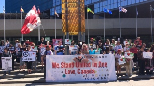 We Stand United in One Love Canada rally