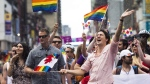 Prime Minister Justin Trudeau is splashed with water as he waves a flag while taking part in the annual Pride Parade in Toronto on Sunday, July 3, 2016. Trudeau will be returning to one of Canada's largest Pride celebrations this weekend.Pride Toronto, organizers of the city's festival celebrating the LGBTQ community, says Trudeau will be marching in Sunday's parade again this year. THE CANADIAN PRESS/Nathan Denette