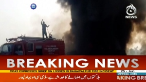 In this image taken from video, black smoke rises from oil tanker on road in Bahawalpur, Pakistan, Sunday, June 25, 2017. (AAJ News via AP Video)