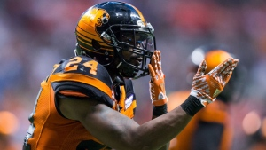 B.C. Lions' Jeremiah Johnson celebrates his touchdown by blowing kisses to the crowd during the second half of a CFL football game against the Edmonton Eskimos in Vancouver, B.C., on Saturday, June 24, 2017. (THE CANADIAN PRESS/Darryl Dyck)