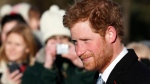 Prince Harry arrives to attend a Christmas Day Service with other members of the royal family at St. Mary's church on the grounds of Sandringham Estate, the Queen's royal estate in Norfolk, England, Wednesday, Dec. 25, 2013. (AP / Lefteris Pitarakis)