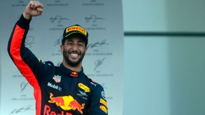Red Bull driver Daniel Ricciardo of Australia celebrates on the podium after winning the Formula One Azerbaijan Grand Prix in Baku, Azerbaijan, Sunday, June 25, 2017. (AP /Darko Bandic)