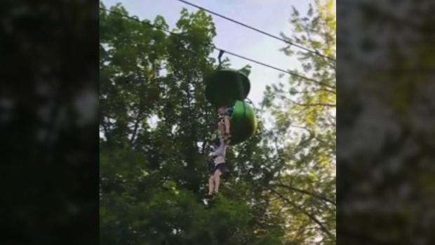 A girl dangles from an amusement park ride at Six Flags Amusement Park in New York.