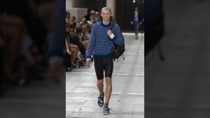 Socks and sandals and shorts for men, seen here on the catwalk at Louis Vuitton, were two of the biggest trends seen at the Men's Fashion Week in Paris this weekend. (BERTRAND GUAY / AFP)