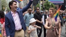 Prime Minister Justin Trudeau, his wife Sophie Gregoire Trudeau and their daughter Ella-Grace walk in the Pride parade in Toronto, Sunday, June 25, 2017. THE CANADIAN PRESS/Mark Blinch