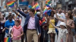Prime Minister Justin Trudeau, his wife Sophie Gregoire Trudeau and their children Ella-Grace and Xavier walk in the Pride parade in Toronto, Sunday, June 25, 2017. (THE CANADIAN PRESS / Mark Blinch)