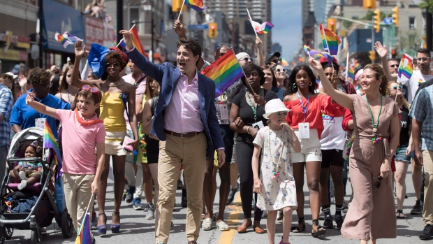 Prime Minister Justin Trudeau, his wife Sophie Gregoire Trudeau and their children Ella-Grace and Xavier walk in the Pride parade in Toronto. (THE CANADIAN PRESS / Mark Blinch)