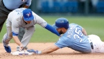 Toronto Blue Jays second baseman Darwin Barney, left, tags out Kansas City Royals' Eric Hosmer, right, in the eighth inning of a baseball game at Kauffman Stadium in Kansas City, Mo., Sunday, June 25, 2017. (AP Photo/Colin E. Braley)
