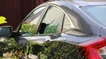 This broken car window was visible at the scene. (CTV)