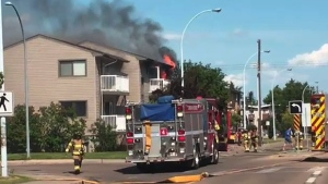 Firefighters on the scene of a fire in an apartment building on 100 Ave. and 154 St. on Sunday, June 25, 2017.