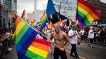 People take part in the Pride parade in Toronto, Sunday, June 25, 2017. (Mark Blinch / THE CANADIAN PRESS)