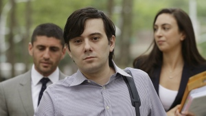 Former Turing Pharmaceuticals CEO Martin Shkreli arrives at Brooklyn federal court with members of his legal team, in New York, for a pretrial conference in his securities fraud trial on Monday, June 19, 2017. (AP / Mark Lennihan)