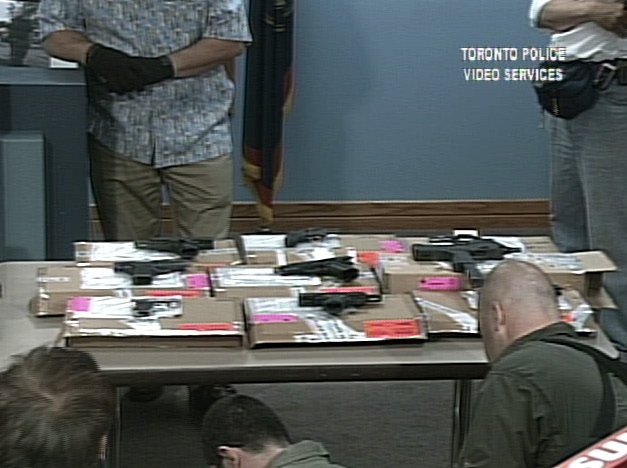 Guns seized during the raid are put on display at Toronto police headquarters pm Thursday, June 14, 2007.