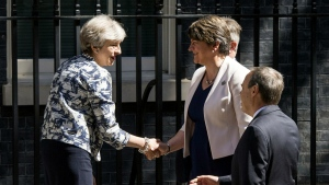 Britain's Prime Minister Theresa May welcomes Democratic Unionist Party (DUP) leader Arlene Foster, center, and DUP deputy leader Nigel Dodds outside 10 Downing Street in London on Monday, June 26, 2017. (Dominic Lipinski / PA)