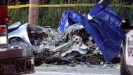 Officials investigate the scene of a serious fatal collision on Winston Churchill Boulevard near the Queen Elizabeth Way in Mississauga on Monday June 26, 2017.