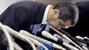 Takata CEO Shigehisa Takada bows at the beginning of a press conference in Tokyo, on June 26, 2017. (Akiko Matsushita / Kyodo News via AP)