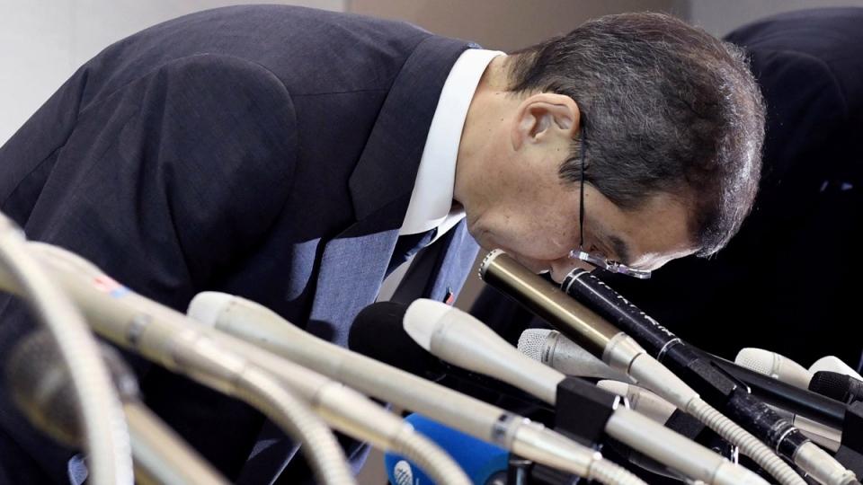 Takata CEO Shigehisa Takada bows at the beginning of a press conference in Tokyo, on June 26, 2017. (Akiko Matsushita / Kyodo News via AP)