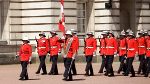 Canadian Captain Megan Couto, left, makes history by becoming the first female Captain of the Queen's Guard as she takes part in the Changing the Guard ceremony at Buckingham Palace in London, Monday, June 26, 2017. (Matt Dunham/AP)