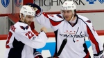Washington Capitals' Kevin Shattenkirk (22) celebrates with T.J. Oshie (77) after scoring the game-winning goal in overtime of Game 3 in an NHL Stanley Cup Eastern Conference semifinal hockey game against the Pittsburgh Penguins in Pittsburgh on Monday, May 1, 2017. (AP /Gene J. Puskar)