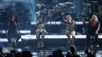 Kandi Burruss, from left, Tamika Scott, Tameka Cottle, and LaTocha Scott of Xscape perform at the BET Awards at the Microsoft Theater on Sunday, June 25, 2017, in Los Angeles. (Photo by Matt Sayles/Invision/AP)