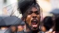 An activist form the Black Livers Matters movement chants during the Pride parade in Toronto, Sunday, June 25, 2017. (THE CANADIAN PRESS/Mark Blinch)