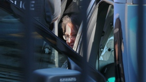 Elizabeth Wettlaufer is escorted by police to the door of the courthouse in Woodstock, Ont. on Monday, June 26, 2017. (THE CANADIAN PRESS/Dave Chidley)