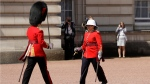 Canadian Captain Megan Couto, right, makes history by becoming the first female Captain of the Queen's Guard as she takes part in the Changing the Guard ceremony at Buckingham Palace in London, Monday, June 26, 2017. (AP Photo/Matt Dunham)