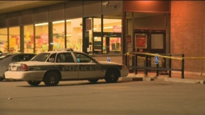 Police tape could be seen in the Safeway parking lot Sunday night.