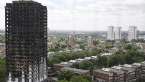 The burnt Grenfell Tower apartment building stands testament to the recent fire in London, Friday, June 23, 2017. (Frank Augstein/AP)