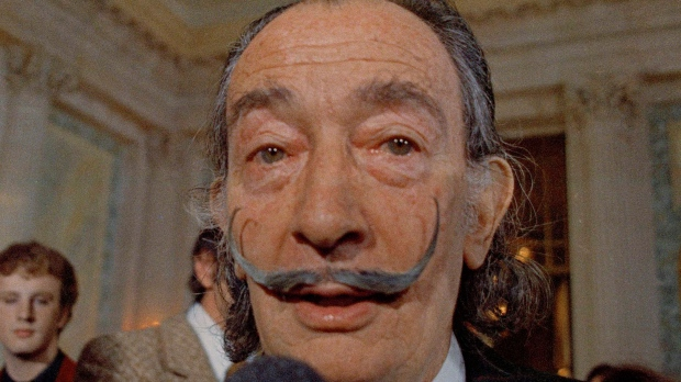 In this May 21, 1973 file photo, Spanish surrealist painter Salvador Dali, presents his first Chrono-Hologram in Paris, France. (AP Photo/Eustache Cardenas, File)