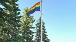Members and supporters of the Taber Equality Alliance attend the raising of their Pride flag on June 12, 2017. (THE CANADIAN PRESS / HO-Taber Equality Alliance, Jillian Demontigny)