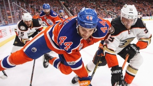 Anaheim Ducks' Jakob Silfverberg (33) and Edmonton Oilers' Zack Kassian (44) battle for the puck during the third period in game six of a second-round NHL hockey Stanley Cup playoff series in Edmonton on Sunday, May 7, 2017. THE CANADIAN PRESS/Jason Franson