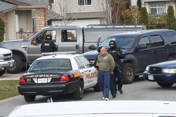 Heavily armed police arrest Jamie Bacon, who police say is a notorious gang member, outside his Abbotsford, B.C., home early morning on Friday, April 3, 2009. (special to ctvbc.ca)