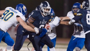 St. Francis Xavier X-Men Ashton Dickson scrambles with the ball against the UBC Thunderbirds in first half of Uteck Bowl action in Antigonish, N.S., on Saturday, Nov. 21, 2015. (THE CANADIAN PRESS/Andrew Vaughan)