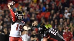 Calgary Stampeders quarterback Bo Levi Mitchell (19) throws the ball as Ottawa Redblacks' Connor Williams (99) rushes forward, during second-half CFL action in Ottawa on Friday, June 23, 2017. It didn't take long for instant replay to again become an issue in each of the CFL's first two games of the 2017 season.(Justin Tang/THE CANADIAN PRESS)