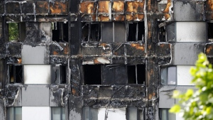 One of the lowest apartments  gutted by fire in the Grenfell Tower apartment building in London is shown Friday, June 23, 2017. (Frank Augstein/THE ASSOCIATED PRESS)