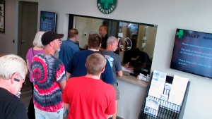 FILE - In this July 31, 2015, file photo, people line up to be among the first in Nevada to legally purchase medical marijuana at the Silver State Relief dispensary in Sparks, Nev. (AP Photo/Scott Sonner, File)