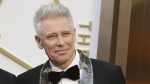 Adam Clayton of U2 arrives at the Oscars at the Dolby Theatre in Los Angeles on March 2, 2014. (Jordan Strauss / Invision)