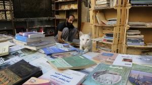 Hamzeh AlMaaytah sorts books at his Mahall al-Maa bookstore, in Jordan's capital, Amman on Thursday, June 15, 2017. (AP / Reem Saad)