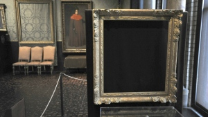 Empty frames from which thieves took 'Storm on the Sea of Galilee,' left background, by Rembrandt and 'The Concert,' right foreground, by Vermeer, remain on display at the Isabella Stewart Gardner Museum in Boston on March 11, 2010. (AP / Josh Reynolds)