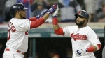 Cleveland Indians' Edwin Encarnacion, left, and Carlos Santana celebrate after both score on Lonnie Chisenhall's two-run single in the sixth inning of a baseball game against the Texas Rangers in Cleveland on Monday, June 26, 2017. (AP / Tony Dejak)
