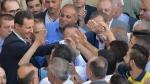 Syrian President Bashar Assad, left, at the Nouri Mosque in Hama, Syria, on June 25, 2017. (SANA via AP)