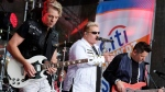 In this May 22, 2017, file photo, Rascal Flatts band members, from left, Joe Don Rooney, Gary LeVox and Jay DeMarcus perform on NBC's 'Today' show at Rockefeller Plaza in New York. The band surprised a bride and groom in Watertown, Wisconsin, on Saturday, June 24, 2017. (Photo by Charles Sykes/Invision/AP, File)