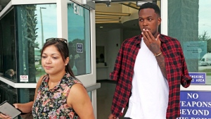 Jacklyne Ramos, left, Senior Director of Communications ,Orlando City Soccer Club accompanies player Cyle Larin as he leaves the Orange County Jail, June 15, 2017 in Orlando, Fla. (THE CANADIAN PRESS/AP-Orlando Sentinel-Red Huber)