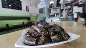 In this Tuesday, June 20, 2017, photo, a plate of North Korean blood sausages sits on a table at Howol-ilga, a restaurant in Incheon, South Korea. (AP / Ahn Young-joon)