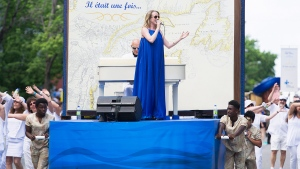 """Annie Villeneuve entertains the crowd during the annual Saint-Jean-Baptiste day parade in Montreal, Saturday, June 24, 2017. Saint-Jean-Baptiste society president Maxime Laporte, of the group responsible for putting on the parade, is rejecting accusations of racism regarding the selection of young men of colour who were pushing the float along the route as """"injustice and exaggeration"""". THE CANADIAN PRESS / Graham Hughes"""